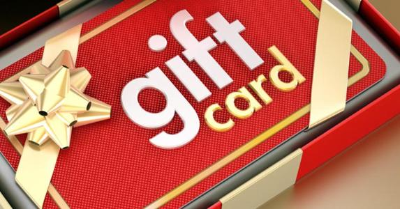 Gift card with gold bow in a box © iStock