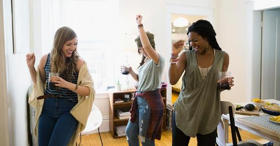 Girlfriends dancing at home | Hero Images/Getty Images