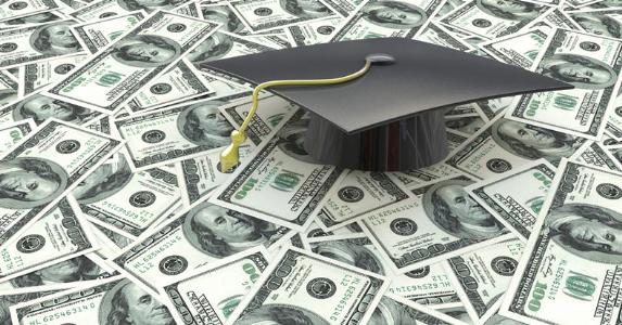 Graduation cap on $100 bills © iStock