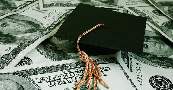 Graduation cap on $100 bills © zimmytws/Shutterstock.com