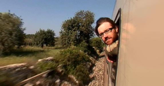 Graham Hughes on a train | Graham Hughes