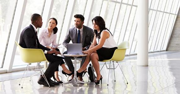 Group of employees sitting together at table © Monkey Business Images/Shutterstock.com