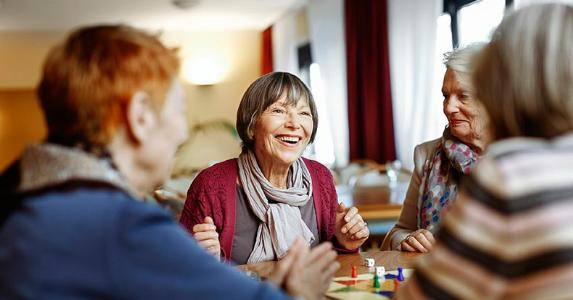 Group of senior women playing a board game | Hinterhaus Productions/Getty Images