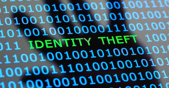 Hand hovering over codes, identity theft online © iStock
