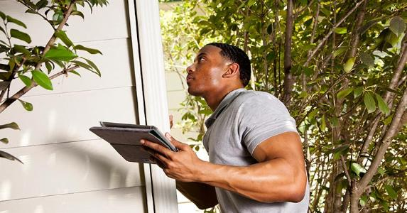 Home inspector checking house exterior | Pamela Moore/E+/Getty Images