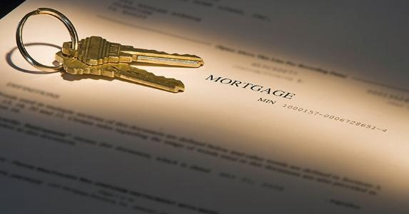 House keys on mortgage document © iStock