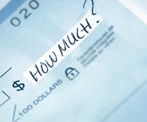 'How much?' written on a check © iStock