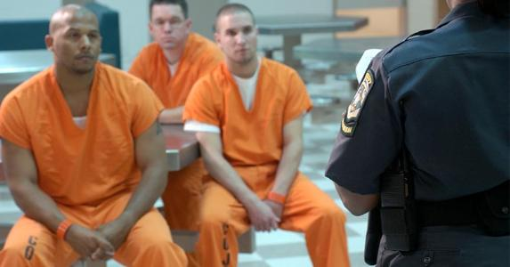 Inmates listening to correctional officer | Thinkstock/Getty Images