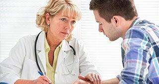 Doctor consoling patient © Alexander Raths/Shutterstock.com