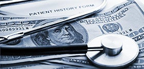 Stethoscope on hundred dollar bills © isak55/Shutterstock.com