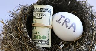IRA egg with roll of money © Don Mammoser/Shutterstock.com