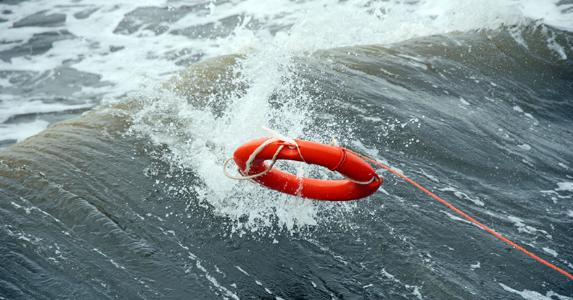Life preserver in middle of the ocean © iStock
