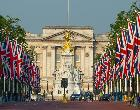 Line of UK flags in front of government building | Neil Emmerson/Getty Images