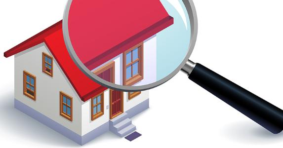 Magnifying glass on house model