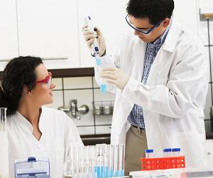 Male and female scientists working in a laboratory © iStock