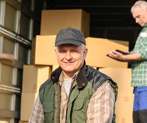 Male movers loading truck with boxes  © CandyBox Images/Shutterstock.com