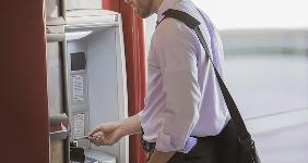 Man inserting card into ATM   Mint Images RF/Getty Images