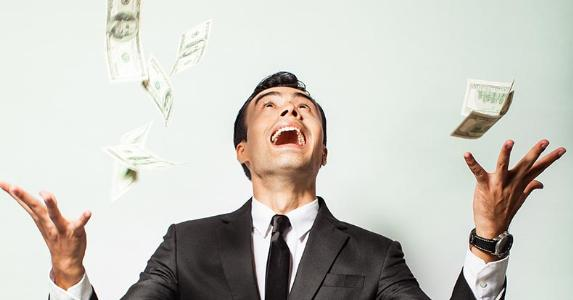 Man in suit excited about money falling © KieferPix/Shutterstock.com