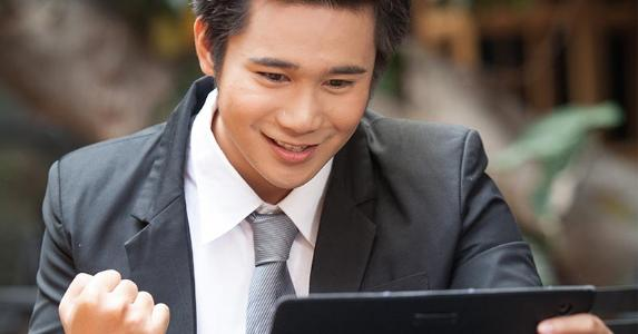 Man excited about content on tablet screen | pan_kung/Shutterstock.com