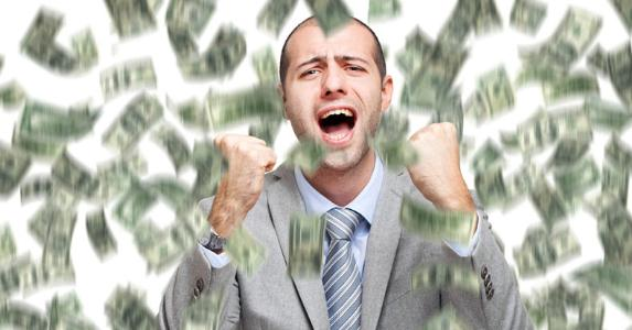 Rich man triumphantly shaking his fists | iStock.com