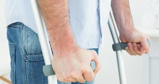 Man with crutches © lightwavemedia/Shutterstock.com