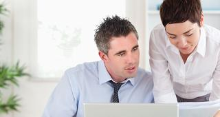 Man and woman working in the office © wavebreakmedia/Shutterstock.com