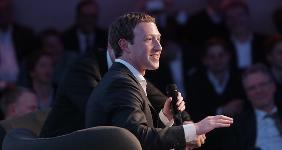 Mark Zuckerberg holding microphone | KAY NIETFELD /Getty Images