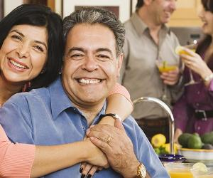 Mature couple in kitchen house party | Monkey Business Images/Shutterstock.com