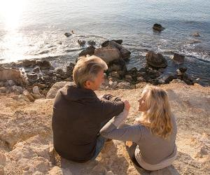 Mature couple sitting on cliff   Ascent Xmedia/Getty Images