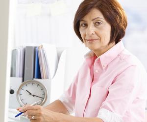 Mature female office worker taking notes © StockLite/Shutterstock.com
