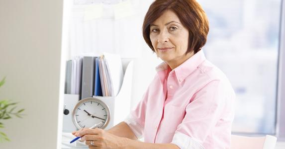 Mature female office worker taking notes © StockLite/Shutterstock.com