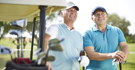 Couple of mature male golfers | Chris Ryan/Getty Images