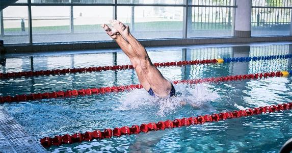 Mature person jumping into pool   wavebreakmedia/Shutterstock.com