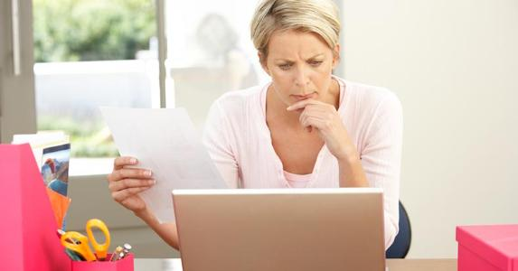 Woman thinking about her budget | iStock.com/monkeybusinessimages