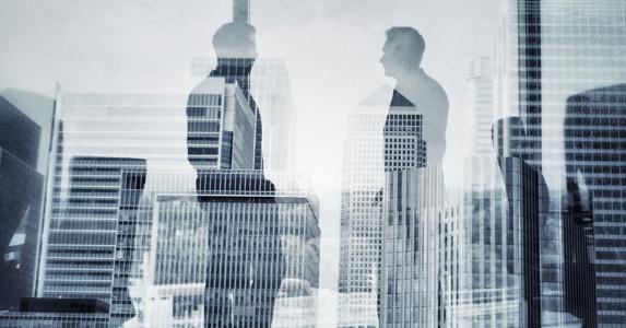 Men standing in office, talking © iStock