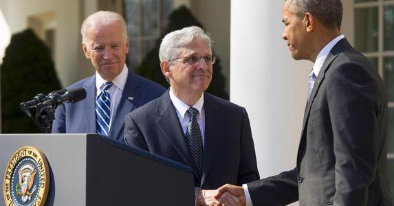Merrick Garland shaking hands with President Barack Obama | SAUL LOEB/AFP/Getty Images