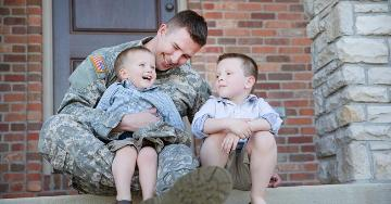 Military father sitting with his 2 sons | Veterans United