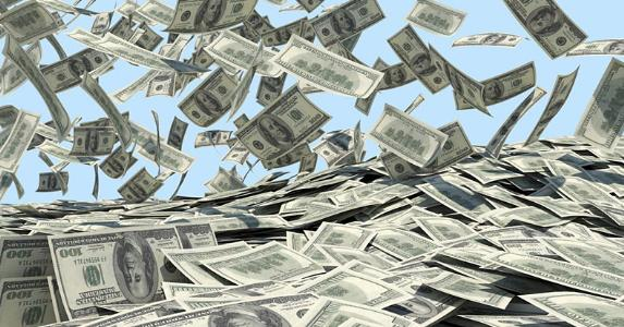 Money falling from sky into a pile © iStock