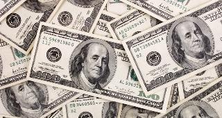 $100 bills © Luis Carlos Torres/Shutterstock.com