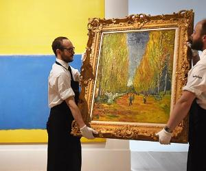 Museum curators holding a Van Gogh painting | Mary Turner/GettyImages