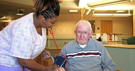 Nurse checking blood pressure © Andrew Gentry/Shutterstock.com