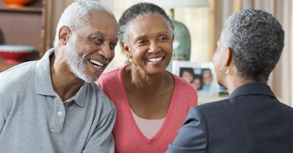 Older couple shaking hands with adviser in home   Ariel Skelley/Blend Images/Getty Images