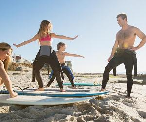 People training to surf | Hero Images/Getty Images