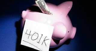 Piggy bank with dollar and 401k © zimmytws/Shutterstock.com