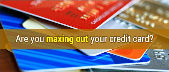 Are you maxing out your credit card?  © Marie C Fields/Shutterstock.com