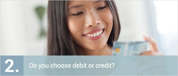 Do you choose debit or credit? © Jeff A. Moore/Shutterstock.com