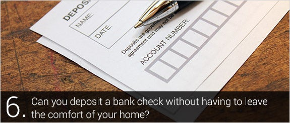 Can you deposit a bank check without having to leave the comfort of your home? © R. MACKAY PHOTOGRAPHY, LLC/Shutterstock.com