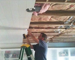 John Melton installing ceiling planks