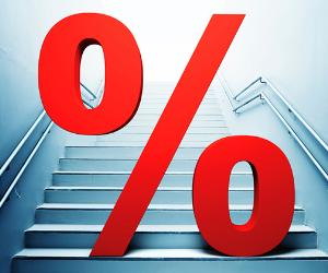 Red 'percent' sign on stairs © iStock