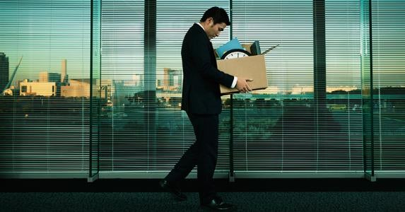Man holding box full of office stuff